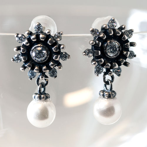 silver earring with white pearls