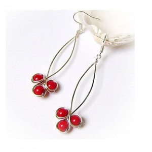 wore wrapped red coral earring